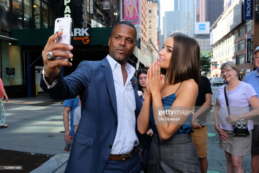AJ Calloway (L) and Olivia Culpo take a selfie during her visit to 'Extra' on September 4, 2018 in New York City.
