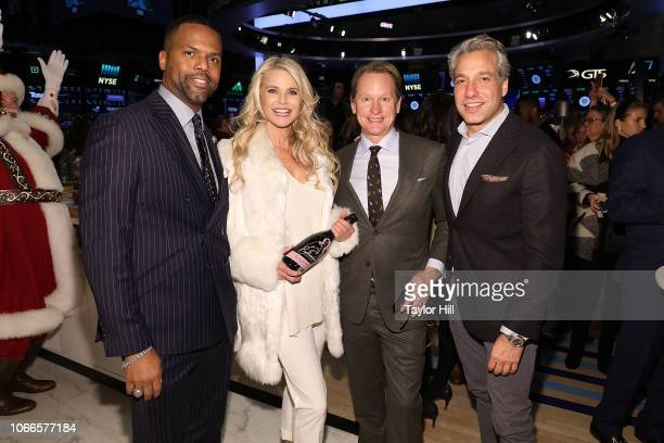 J Calloway Christie Brinkley Carson Kressley and Thom Filicia pose together at New York Stock Exchange on November 29 2018 in New York City