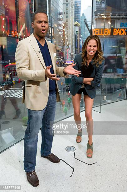Calloway interviews Chrissy Teigen during her visit to 'Extra' at their New York studios at HM in Times Square on May 8 2014 in New York City