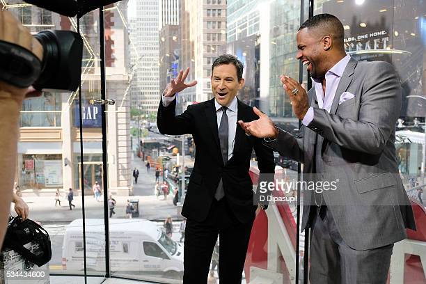 Calloway interviews Dan Harris during his visit to 'Extra' at their New York studios at HM in Times Square on May 26 2016 in New York City