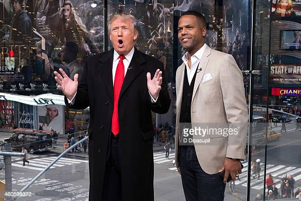 Calloway interviews Donald Trump during his visit to 'Extra' at their New York studios at H&M in Times Square on December 17, 2014 in New York City.