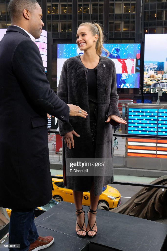 AJ Calloway (L) interviews Hannah Jeter during her visit to 'Extra' at their New York studios at the Hard Rock Cafe in Times Square on February 14, 2017 in New York City.