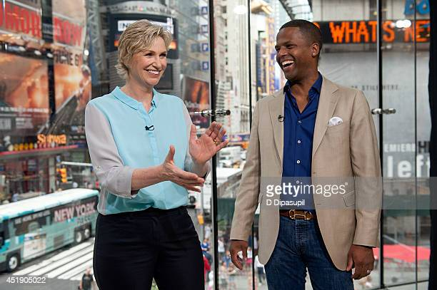 Calloway interviews Jane Lynch during her visit to 'Extra' at their New York studios at HM in Times Square on July 9 2014 in New York City
