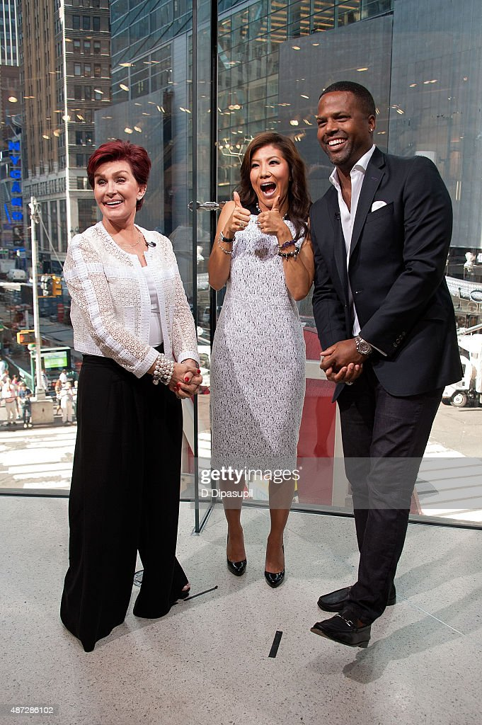 AJ Calloway interviews Julie Chen and Sharon Osbourne during their visit to 'Extra' at their New York studios at H&M in Times Square on September 8, 2015 in New York City.