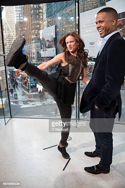 "Calloway interviews Juliette Lewis during her visit to ""Extra"" at their New York studios at H&M in Times Square on March 2, 2015 in New York City."