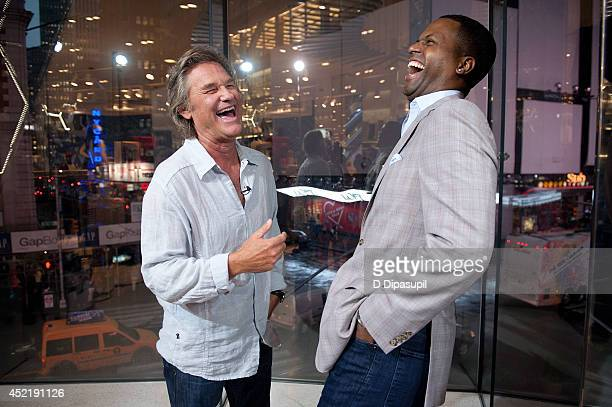"""Calloway interviews Kurt Russell during his visit to """"Extra"""" at their New York studios at H&M in Times Square on July 15, 2014 in New York City."""