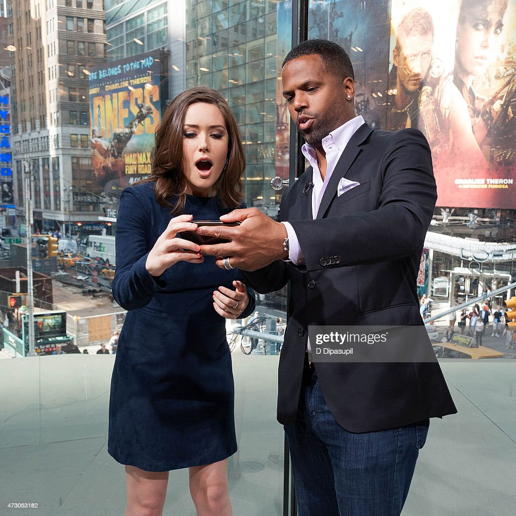 AJ Calloway (R) interviews Megan Boone during her visit to 'Extra' at their New York studios at H&M in Times Square on May 12, 2015 in New York City.