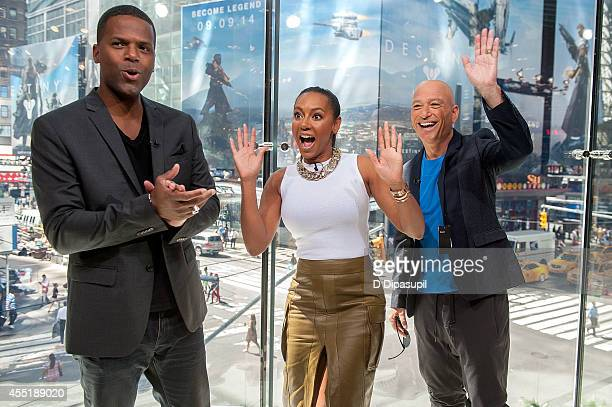 AJ Calloway interviews Mel B and Howie Mandel during their visit to Extra at their New York studios at HM in Times Square on September 10 2014 in New...