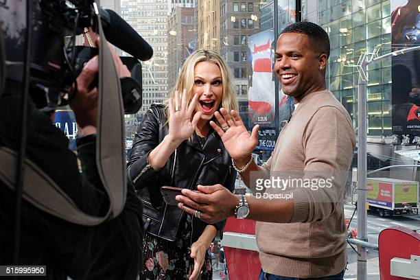 "Calloway interviews Molly Sims during her visit to ""Extra"" at their New York studios at H&M in Times Square on March 15, 2016 in New York City."