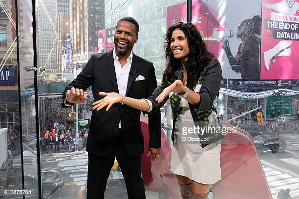 Calloway interviews Padma Lakshmi during her visit to 'Extra' at their New York studios at HM in Times Square on October 5 2016 in New York City
