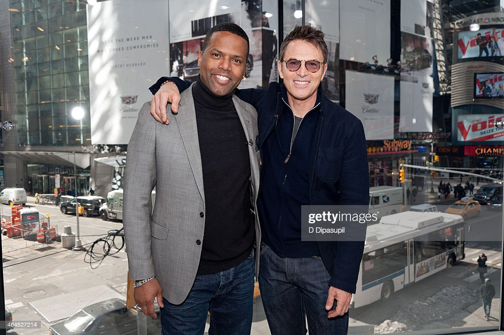 AJ Calloway (L) interviews Tim Daly during his visit to 'Extra' at their New York studios at H&M in Times Square on February 26, 2015 in New York City.