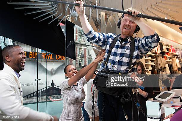 Calloway looks on as Mel B tickles audio technician Ed Bosak on the set of Extra at their New York studios at HM in Times Square on March 31 2015 in...