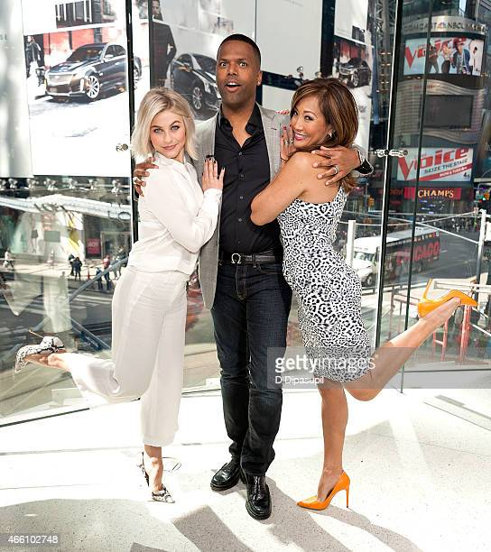 """Calloway poses with Julianne Hough and Carrie Ann Inaba during their visit to """"Extra"""" at their New York studios at H&M in Times Square on March 13,..."""
