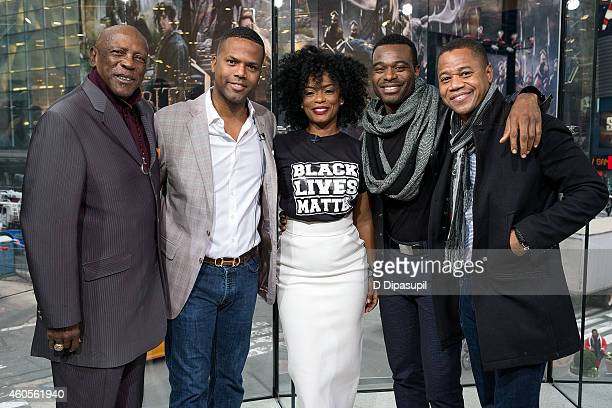 Calloway poses with Louis Gossett Jr, Aunjanue Ellis, Lyriq Bent, and Cuba Gooding Jr during their visit to 'Extra' at their New York studios at H&M...