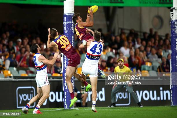 Callum Ah Chee of the Lions marks the ball during the round 11 AFL match between the Brisbane Lions and the Western Bulldogs at The Gabba on August...