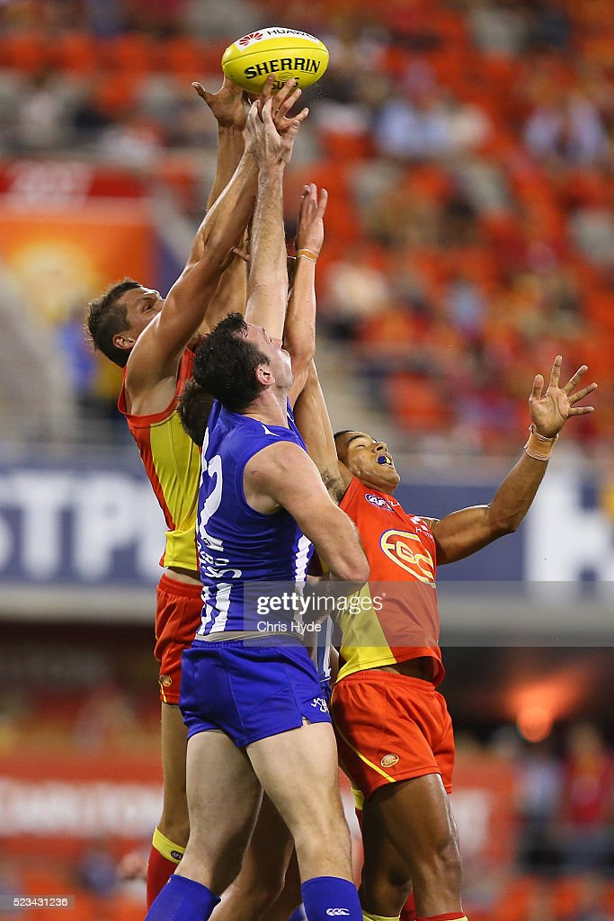 Callum Ah Chee of the Suns and Todd Goldstein of the Kangaroos compete for the ball during the round five AFL match between the Gold Coast Suns and the North Melbourne Kangaroos at Metricon Stadium on April 23, 2016 in Gold Coast, Australia.