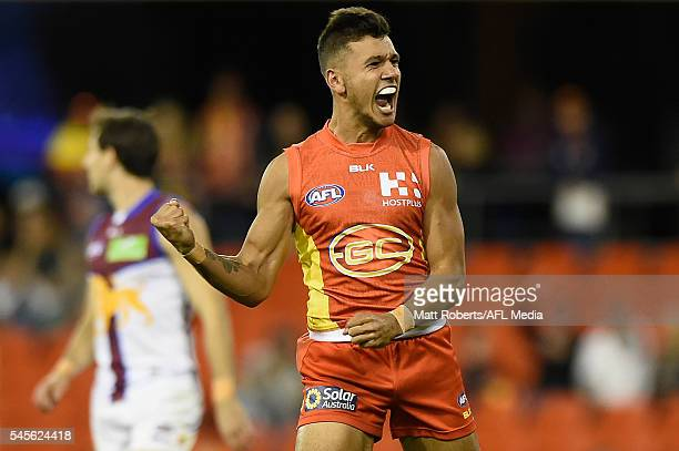 Callum Ah Chee of the Suns celebrates kicking a goal during the round 16 AFL match between the Gold Coast Suns and the Brisbane Lions at Metricon...