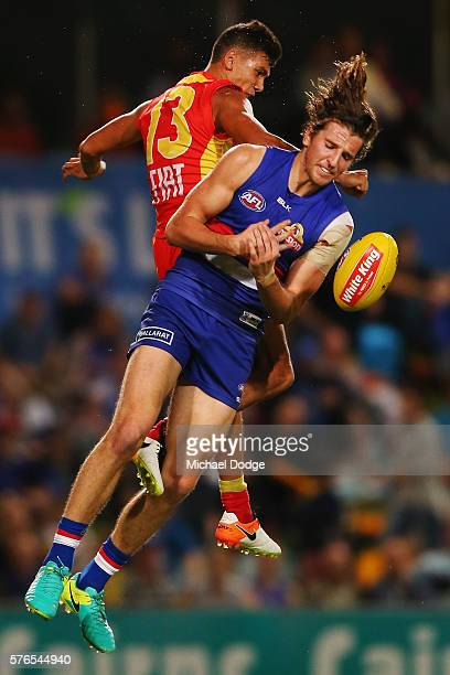Callum Ah Chee of the Suns collides into Marcus Bontempelli of the Bulldogs who marks the ball during the round 17 AFL match between the Western...