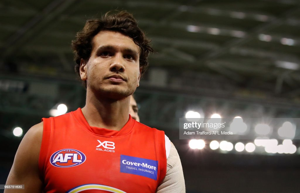 Callum Ah Chee of the Suns looks dejected after a loss during the 2018 AFL round 16 match between the North Melbourne Kangaroos and the Gold Coast Suns at Etihad Stadium on July 08, 2018 in Melbourne, Australia.