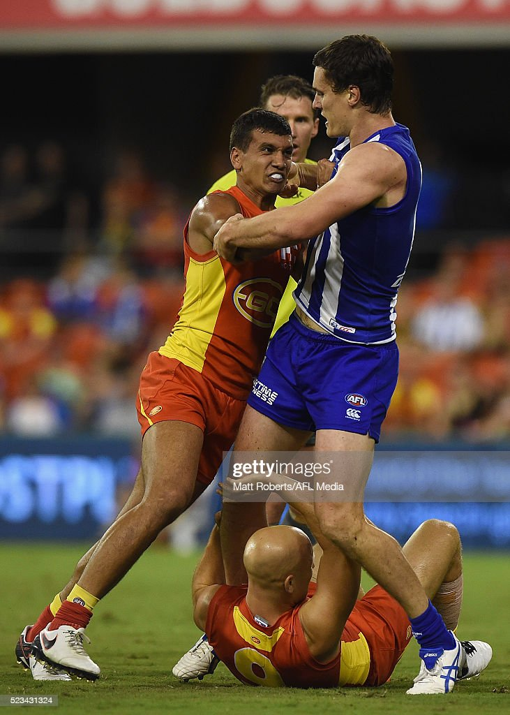 Callum Ah Chee of the Suns pushes Scott D. Thompson of the Kangaroos during the round five AFL match between the Gold Coast Suns and the North Melbourne Kangaroos at Metricon Stadium on April 23, 2016 in Gold Coast, Australia.