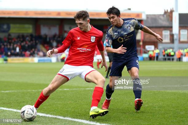 Callum Ainley of Crewe Alexandra battles for possession with Kenny Dougall of Barnsley during the FA Cup Third Round match between Crewe Alexandra...