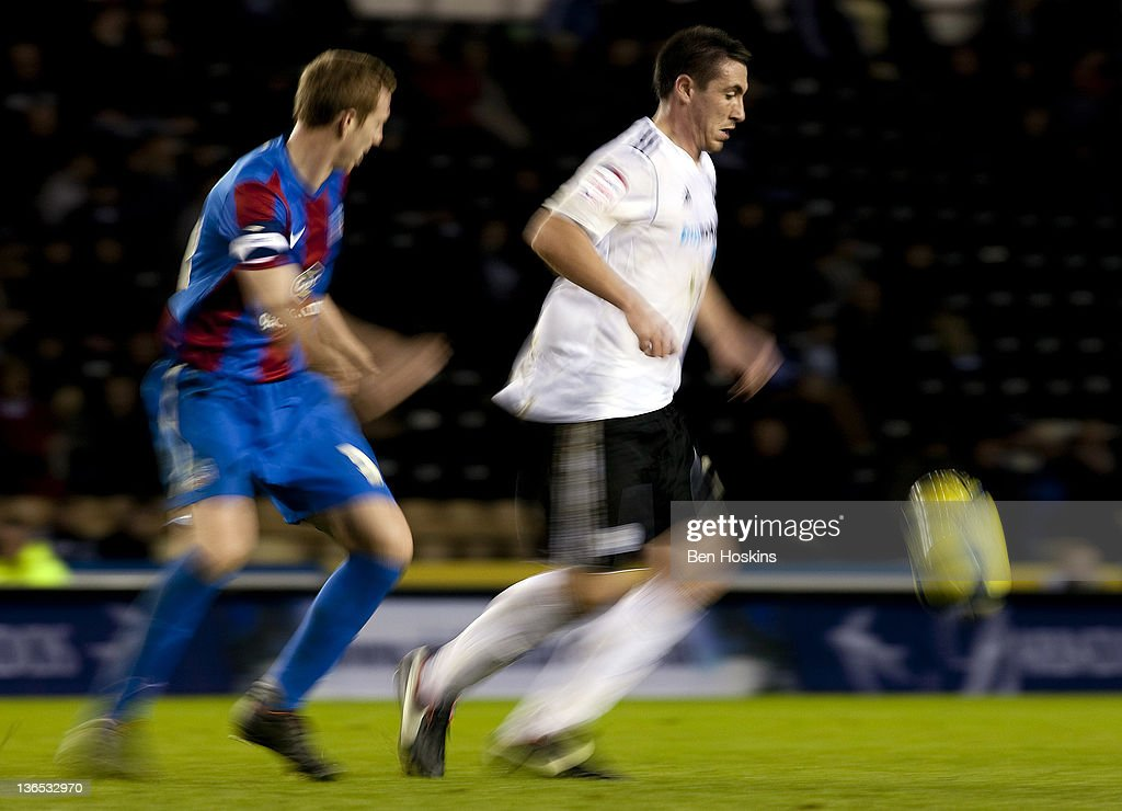 Callum Ball of Derby holds off the challenge of David Wright of Crystal Palace during the FA Cup sponsored by Budweiser Third Round match between Derby County FC and Crystal Palace FC at Pride Park on January 7, 2012 in Derby, England.