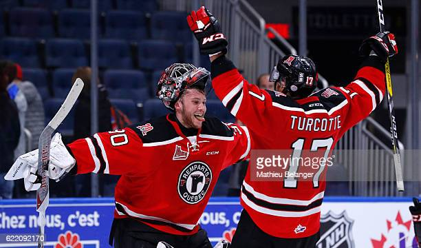 Callum Booth and Yanick Turcotte of the Quebec Remparts celebrate after defeating the Acadie-Bathurst Titan during their QMJHL hockey game at the...