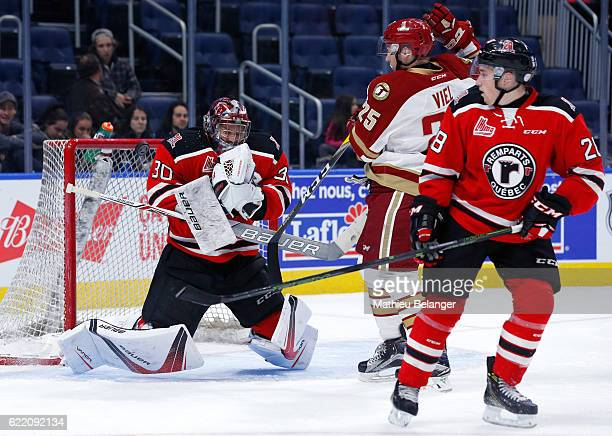Callum Booth of the Quebec Remparts makes a save against the Acadie-Bathurst Titan during their QMJHL hockey game at the Centre Videotron on November...