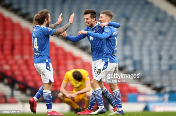 Callum Booth Stevie May and David Wotherspoon of St Johnstone celebrate following during the Betfred Cup Final match between Livingston and St...