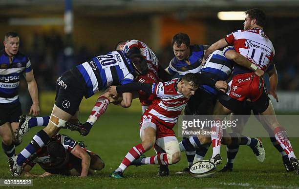 Callum Braley of BGloucester looks at the loose ball as Josh Bayliss and Harry Daves of Bath challenge during the Anglo Welsh Cup match between Bath...