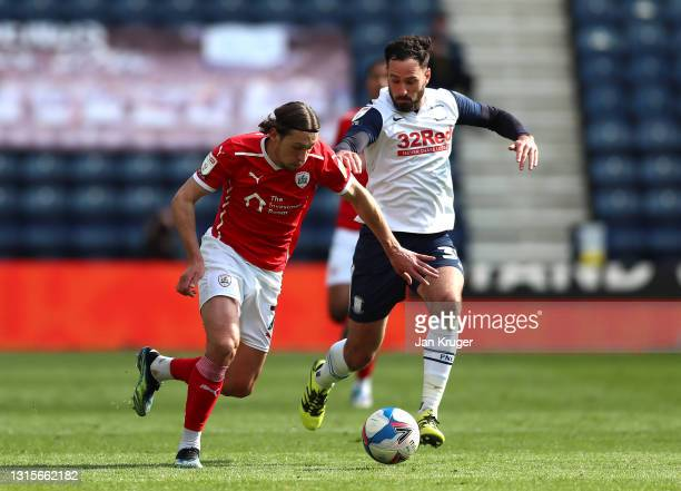 Callum Britain of Barnsley battles with Greg Cunningham of Preston North End during the Sky Bet Championship match between Preston North End and...