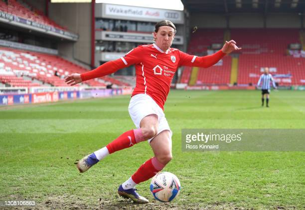 Callum Brittain of Barnsley FC crosses the ball during the Sky Bet Championship match between Barnsley and Sheffield Wednesday at Oakwell Stadium on...
