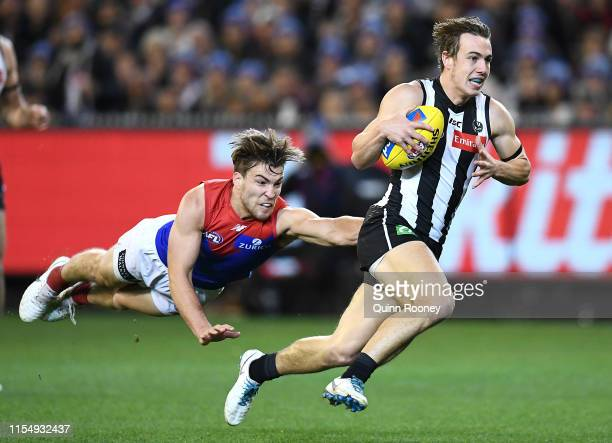 Callum Brown of the Magpies is tackled by Jack Viney of the Demons during the round 12 AFL match between the Collingwood Magpies and the Melbourne...