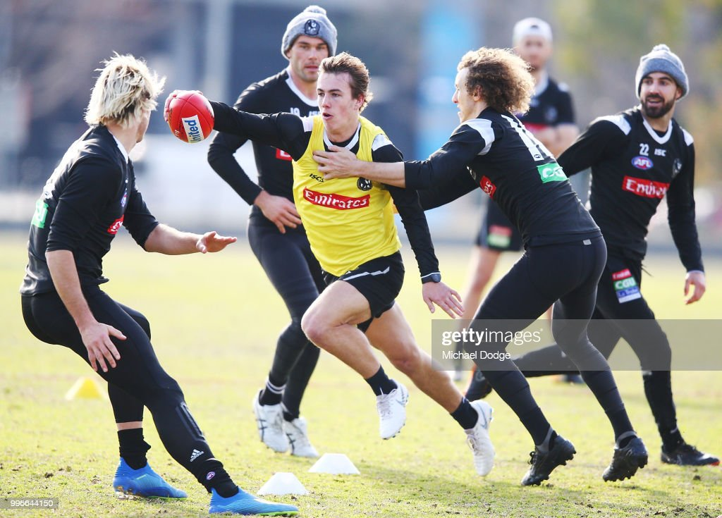 Callum Brown of the Magpies runs with the ball during a Collingwood Magpies AFL press conference at the Holden Centre on July 12, 2018 in Melbourne, Australia.