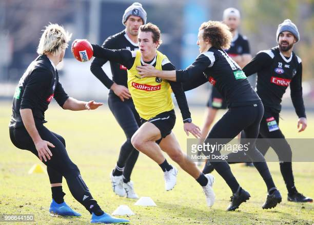 Callum Brown of the Magpies runs with the ball during a Collingwood Magpies AFL press conference at the Holden Centre on July 12 2018 in Melbourne...