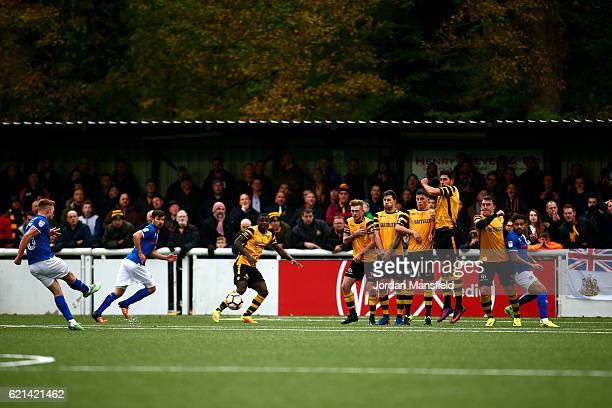 Callum Camps of Rochdale scores their first and equalising goal from a free kick during The Emirates FA Cup first round match between Maidstone...