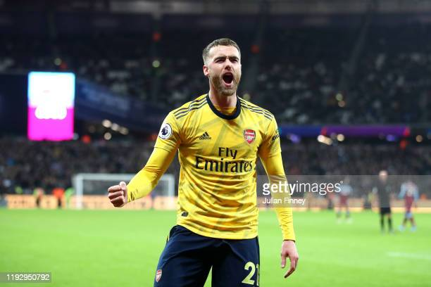 Callum Chambers of Arsenal celebrates their second goal scored by Pierre-Emerick Aubameyang during the Premier League match between West Ham United...