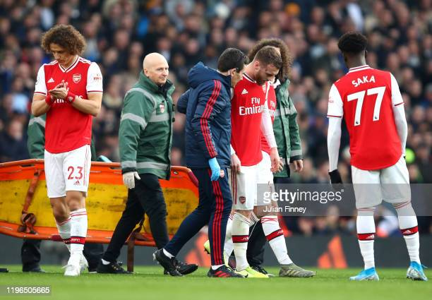 Callum Chambers of Arsenal leaves the pitch following an injury during the Premier League match between Arsenal FC and Chelsea FC at Emirates Stadium...
