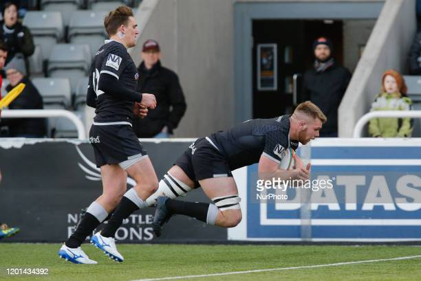 Callum Chick of Newcastle Falcons dives in to score during the Greene King IPA Championship match between Newcastle Falcons and Cornish Pirates at...