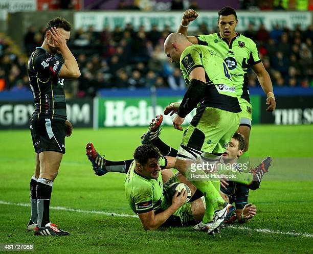 Callum Clark of Saints dives over to score the first try during the European Rugby Champions Cup match between Ospreys and Northampton Saints at the...