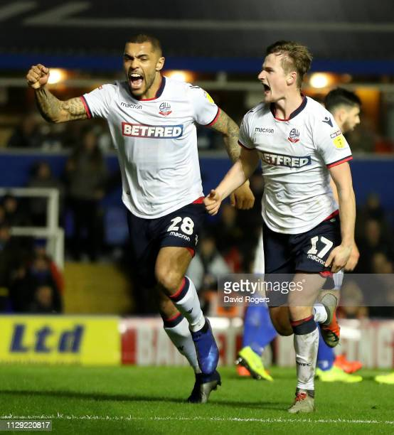 Callum Connolly of Bolton Wanderers celebrates with team mate Josh Magennis after scoring the first goal during the Sky Bet Championship match...