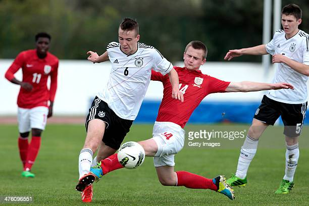 Callum Connolly of England challenges Max Besuschkow of Germany during the Under17 Algarve Cup between U17 England and U17 Germany at Lagos sport...
