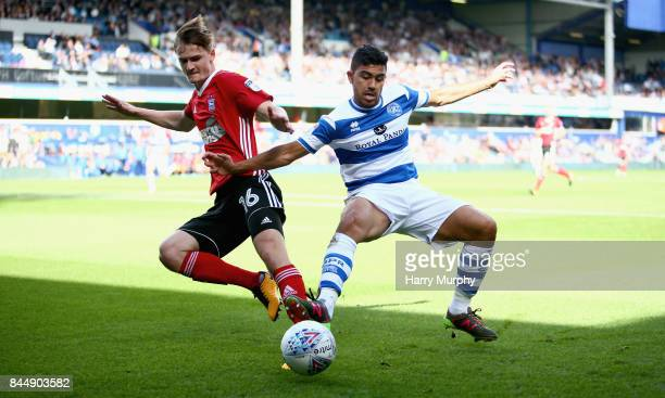Callum Connolly of Ipswich Town and Massimo Luongo of Queens Park Rangers battle for possession during the Sky Bet Championship match between Queens...