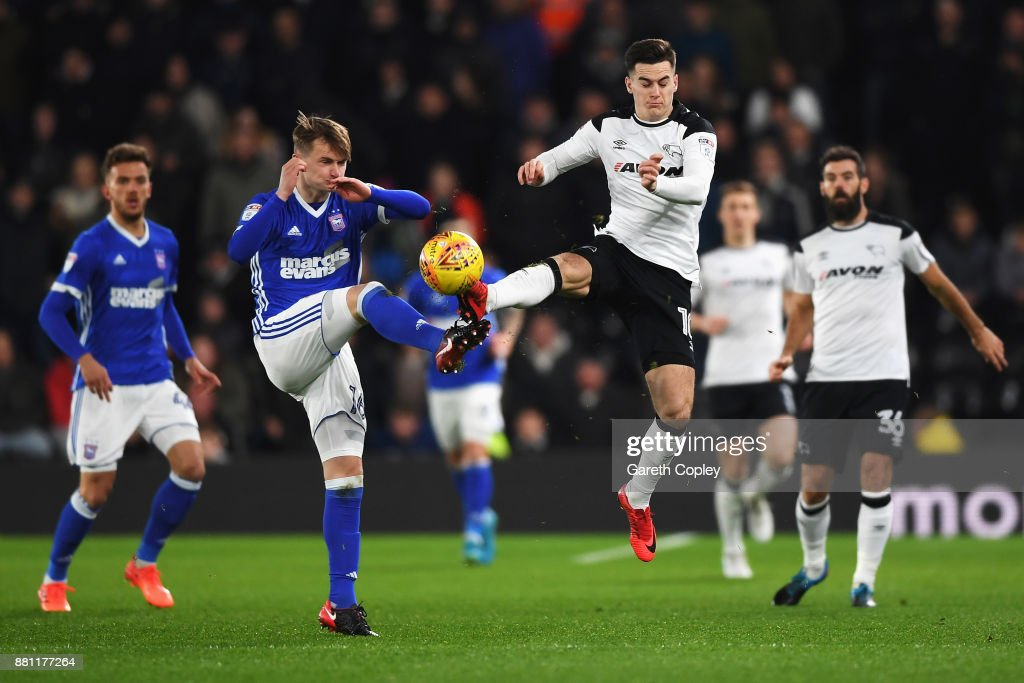 Callum Connolly of Ipswich Town battles for the ball with Tom Lawrence of Derby County during the Sky Bet Championship match between Derby County and Ipswich Town at iPro Stadium on November 28, 2017 in Derby, England.