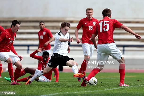Callum Cooke Mandela Egbo Dael Fry of England challenges Finn Porath of Germany during the Under17 Algarve Cup between U17 England and U17 Germany at...