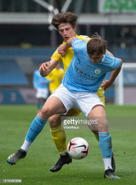 Callum Doyle of Manchester City and Ollie O'Neill of Fulham in action during the U18 Premier League match between Manchester City and Fulham at The...