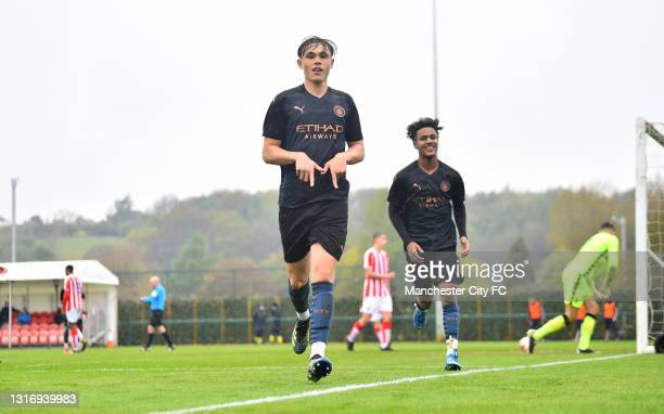 Callum Doyle of Manchester City celebrates after scoring the fifth goal during the U18 Premier League match between Stoke City and Manchester City at...