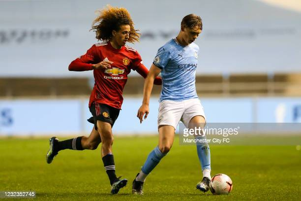 Callum Doyle of Manchester City controls the ball against Hannibal Mejbri of Manchester United during the Premier League 2 match at Manchester City...