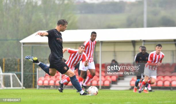 Callum Doyle of Manchester City score the fifth goal during the U18 Premier League match between Stoke City and Manchester City at Clayton Wood...