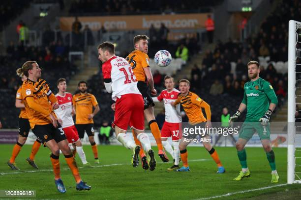 Callum Elder of Hull City heads the ball out of the box during the Sky Bet Championship match between Hull City and Barnsley at KCOM Stadium on...